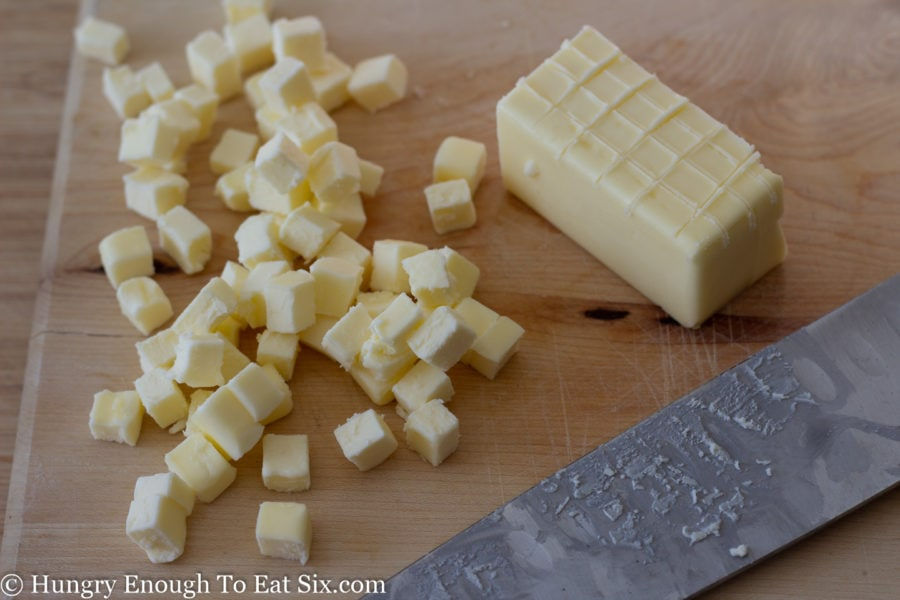 Cubes of butter next to scored butter stick and knife