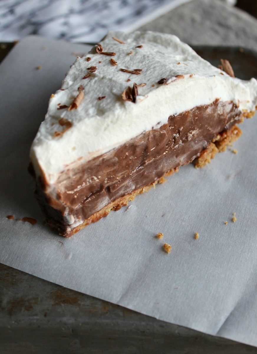 Slice of chocolate pie with whipped cream top