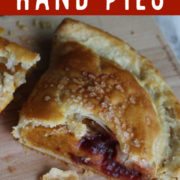 Cu in half hand pie with filling of pumpkin and cranberry
