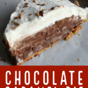 Chocolate pie slice with whipped cream and chocolate shavings