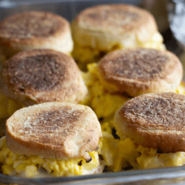 Baked sausage egg and cheese sandwiches in a pan.
