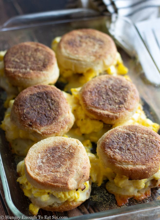 Baked breakfast sandwiches with melted cheese.