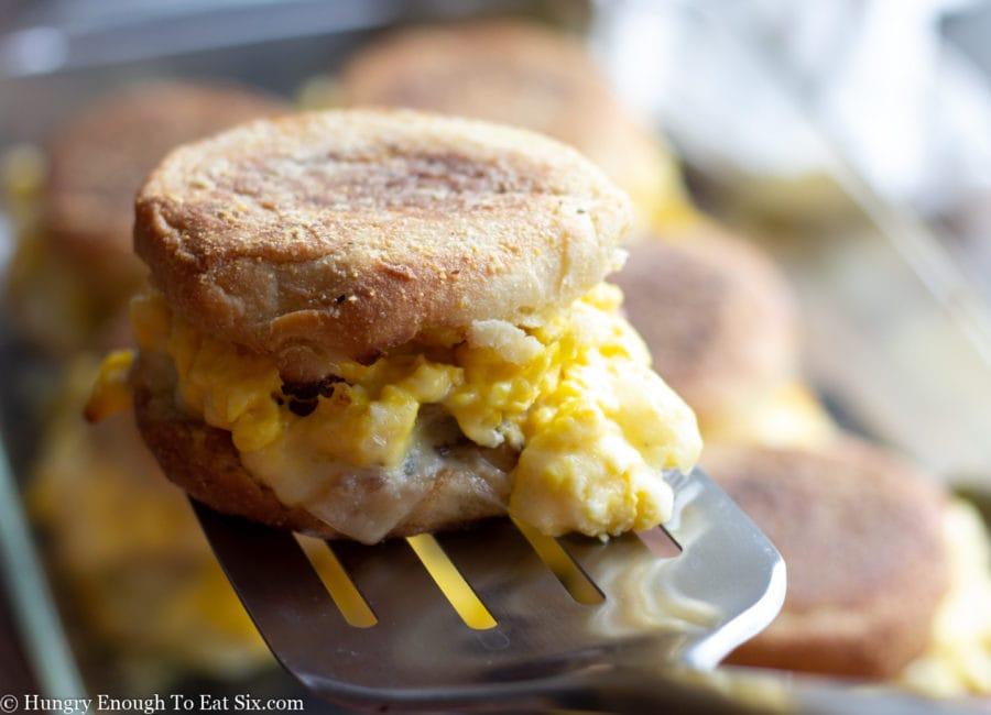 A baked breakfast sandwich resting on a spatula.