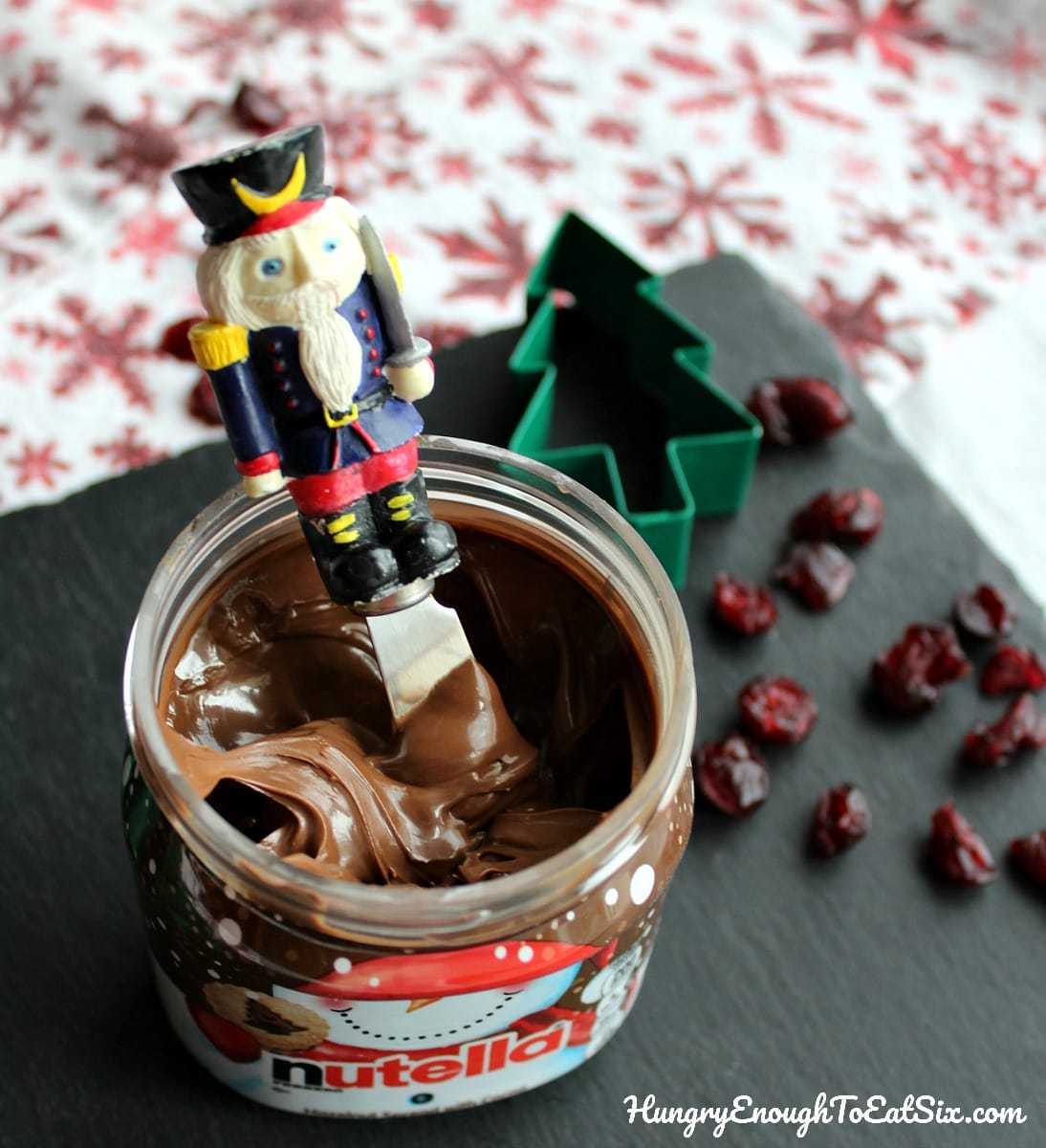 Jar of Nutella with a nutcracker topped spreader