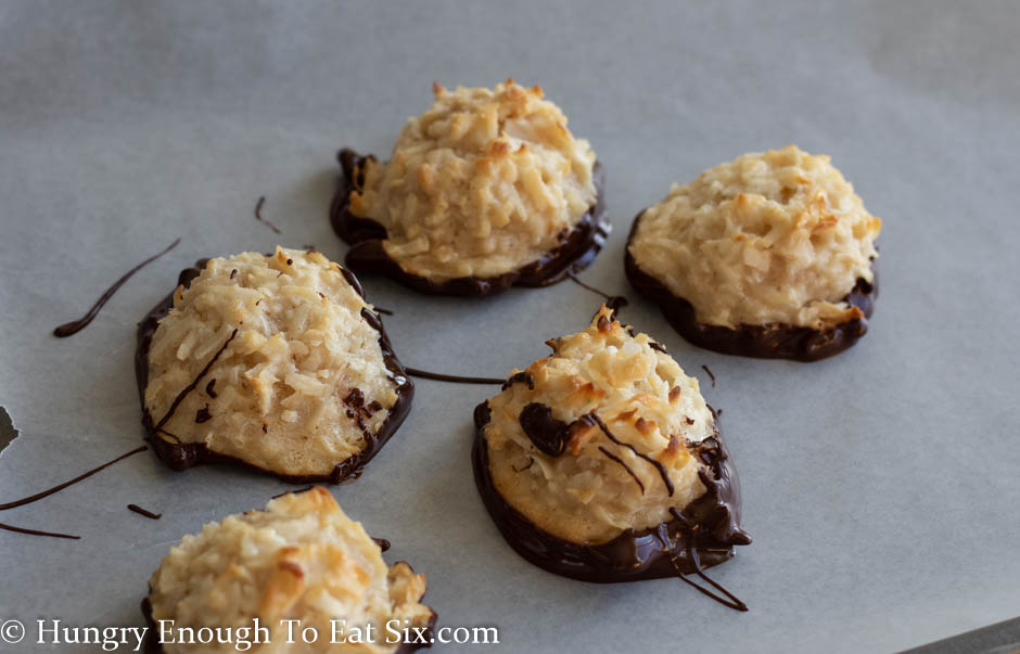 Five macaroons on a piece of parchment paper