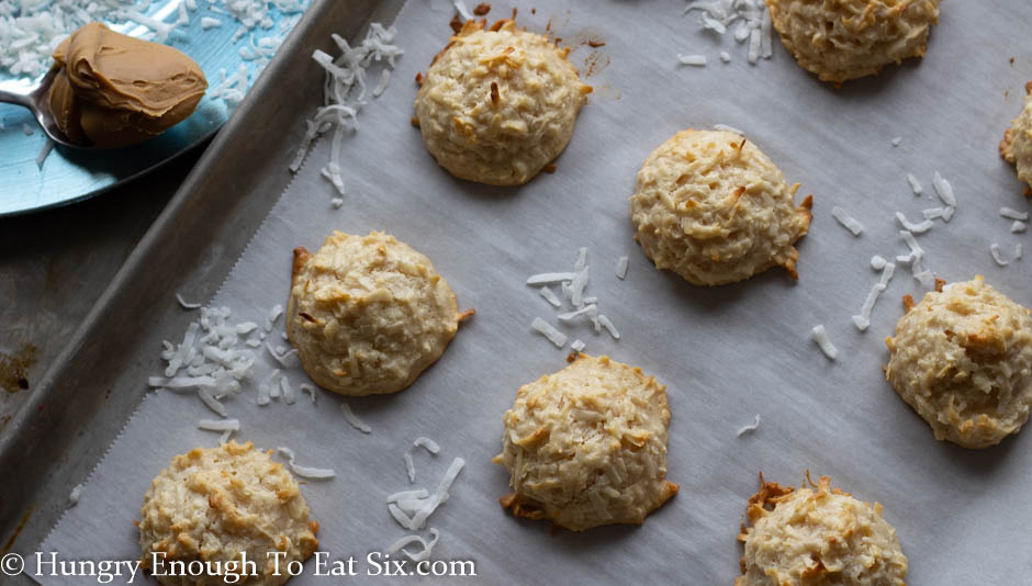 Baked macaroons on a lined baking sheet