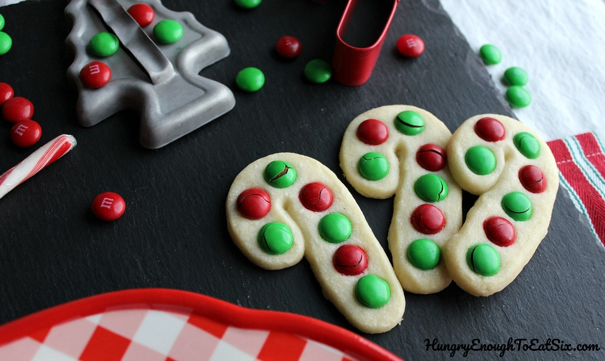 Candy cane shaped cookies with cookie cutters.