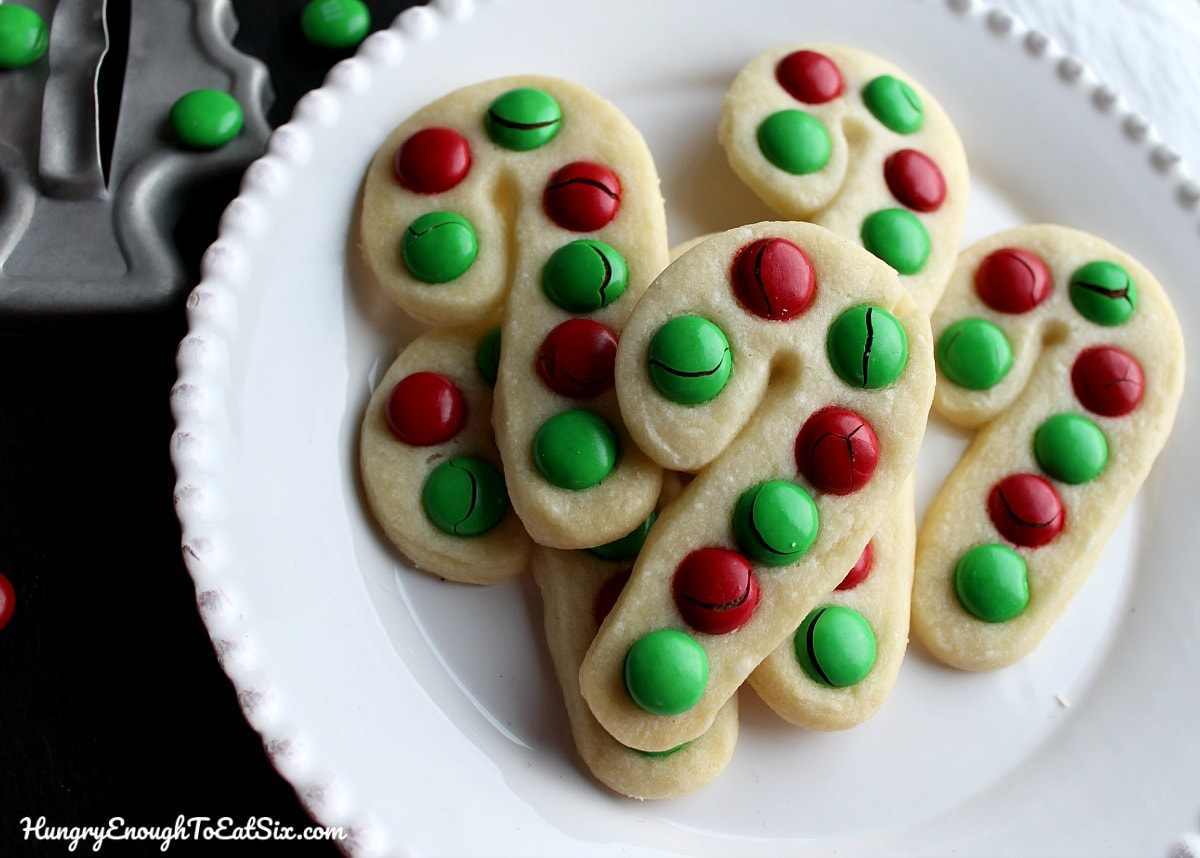 Several Candy Cane Cookies with green and red M&M's.