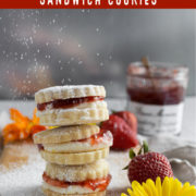 Sandwich cookies stacked with sugar sprinkling down
