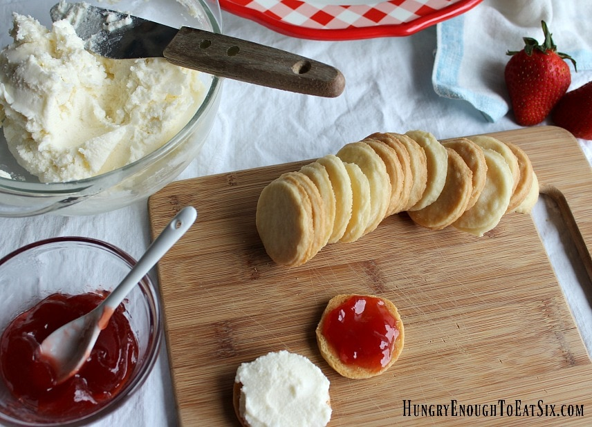 Cutting board with cookies, jam and frosting