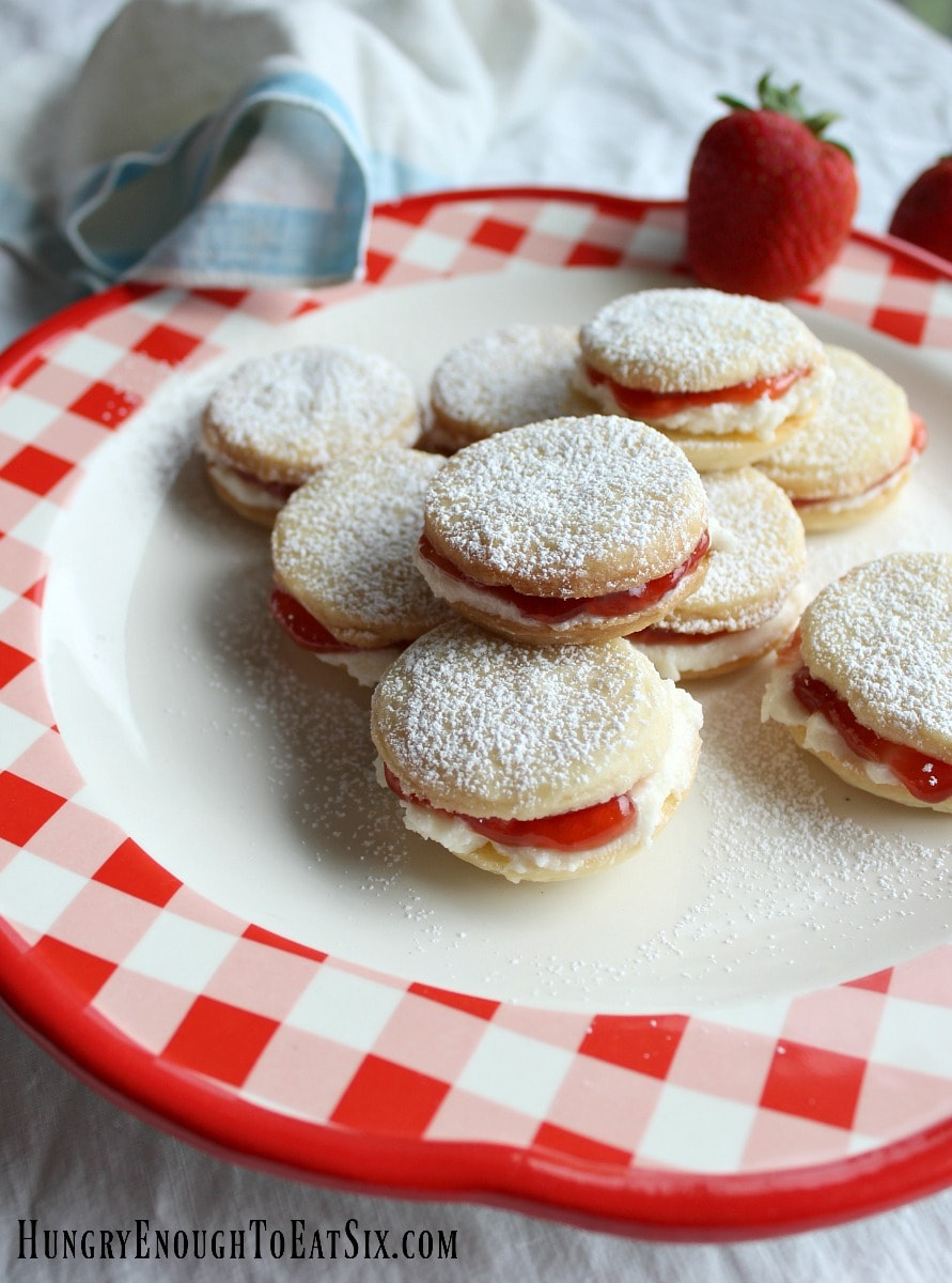 Red and white check plate holding sandwich cookies