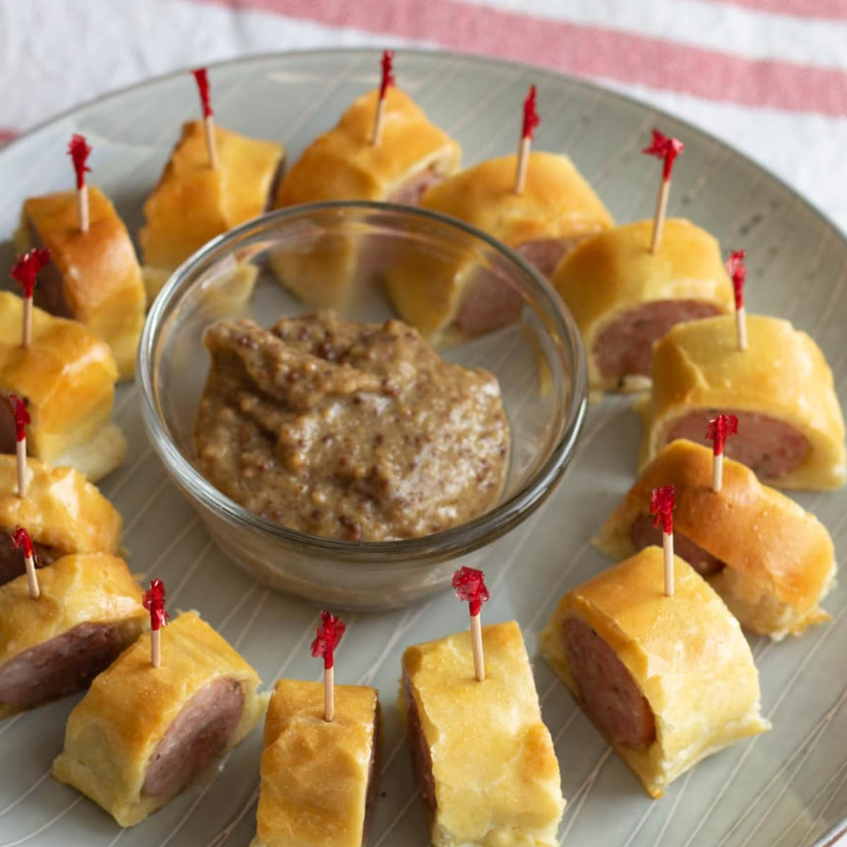 Circle of toothpick skewered sausage pieces on a plate