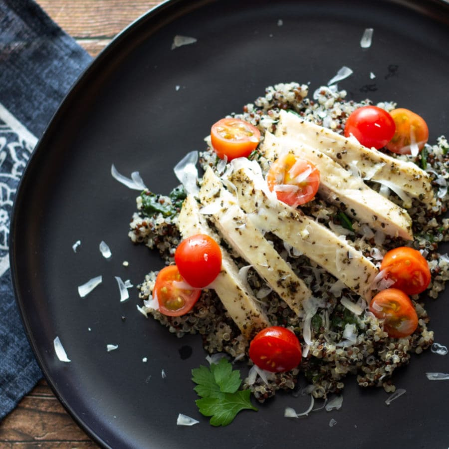 Sliced chicken and cherry tomatoes over quinoa.