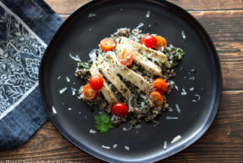 Tricolor quinoa cooked and copped with sliced chicken breast and cherry tomatoes.
