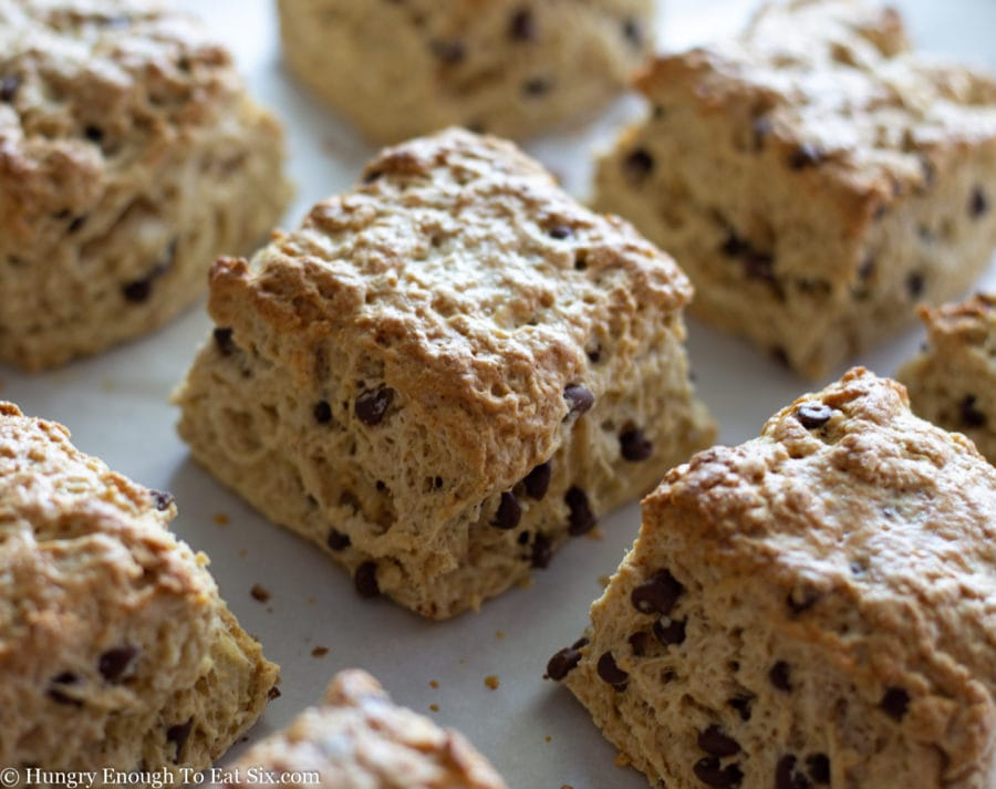 Baked chocolate chip scones on a baking sheet.