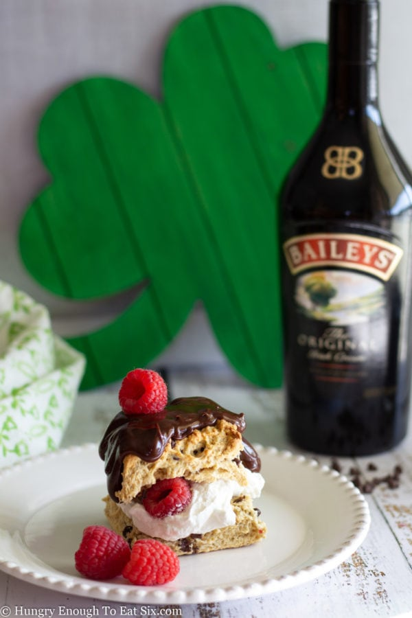 Whiskey chocolate sauce over a scone with cream and berries.