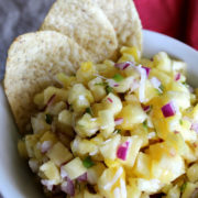 Bowl of pineapple salsa with tortilla chips