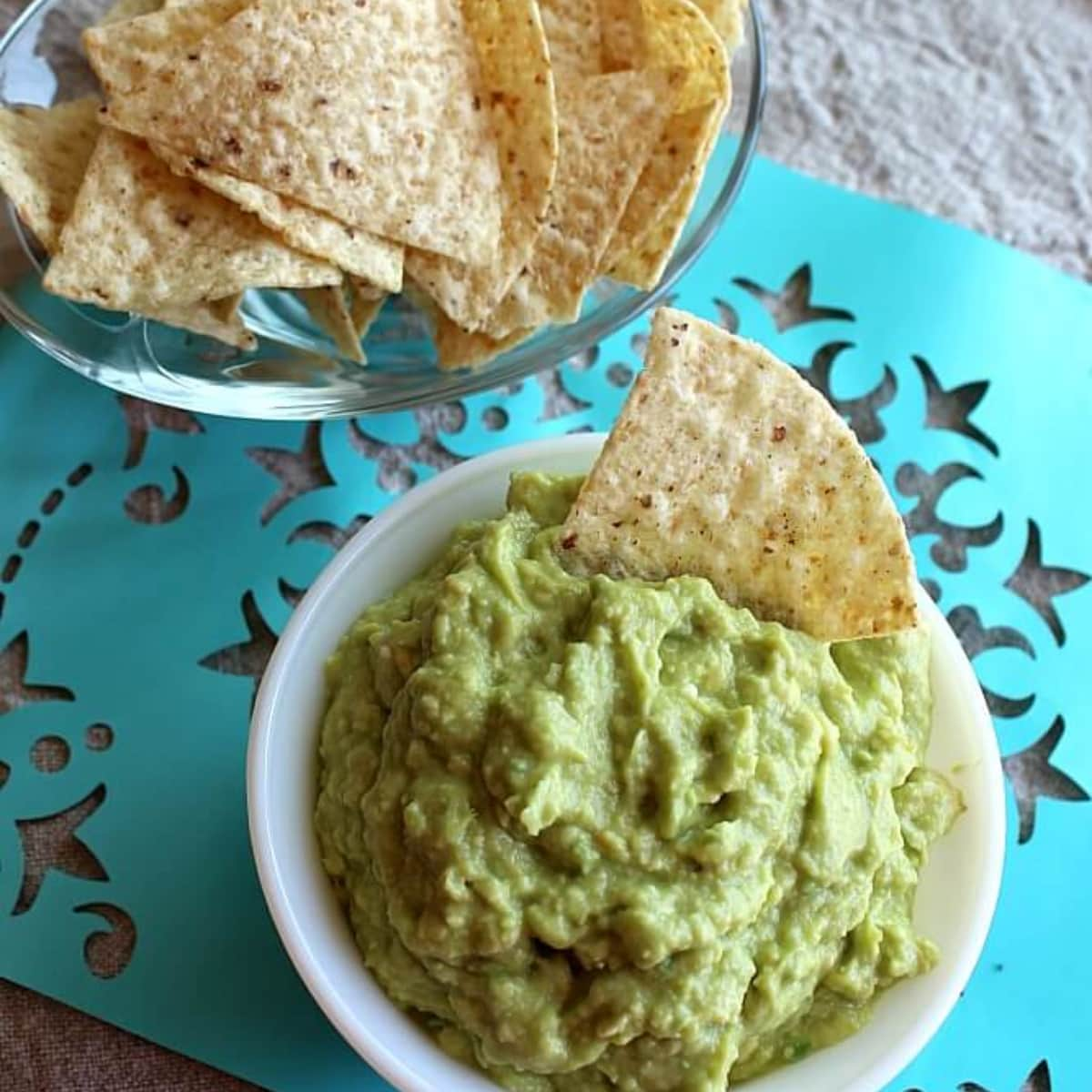 Bowls of guacamole and chips