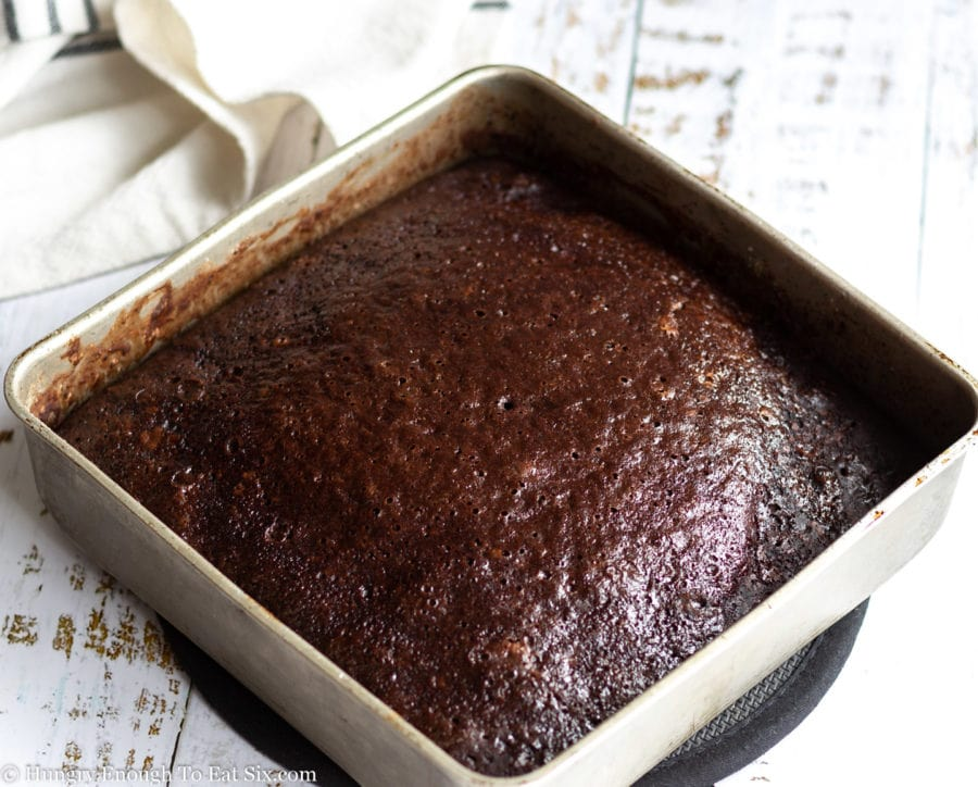 Baked chocolate cake in a square pan.