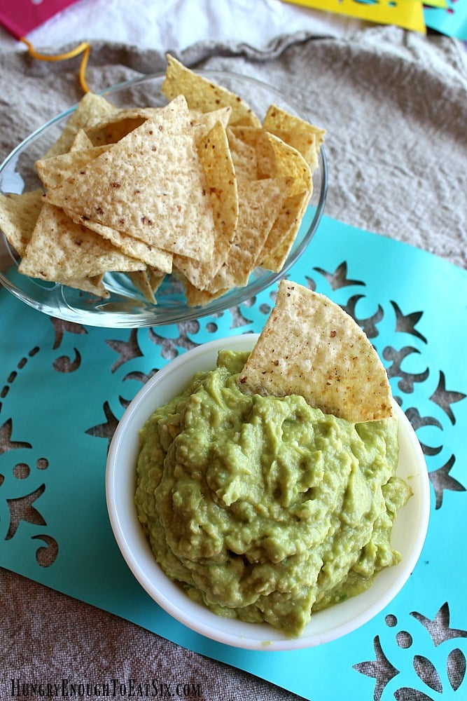 Tortilla chips by a bowl of guacamole
