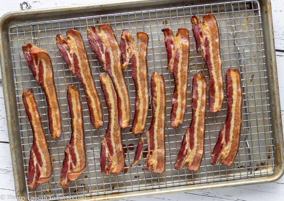 Cooked bacon strips on a wire rack