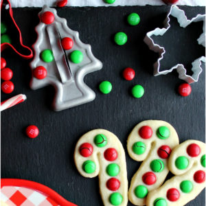 Christmas cookie cutters and cookies with red and green M&Ms.