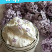 Text overlay on a photo of whipped cream and lilac flowers of light purple color.