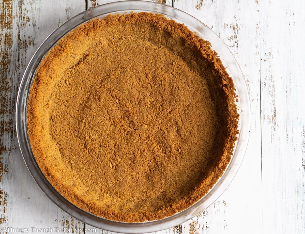Baked, dark brown graham cracker crust