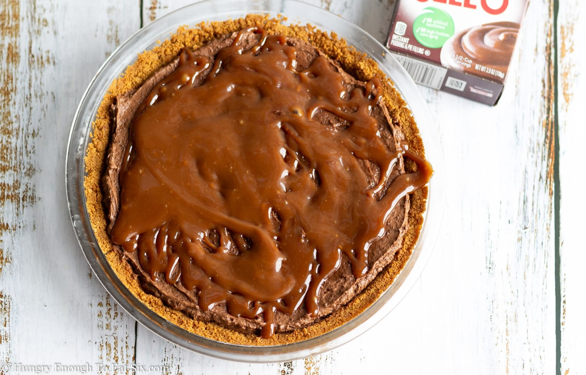 Pie with chocolate filling topped with drizzled caramel