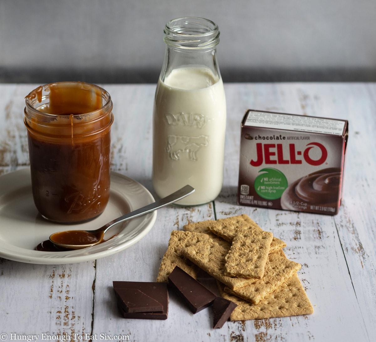 Caramel, cream, graham crackers and a Jell-o box.