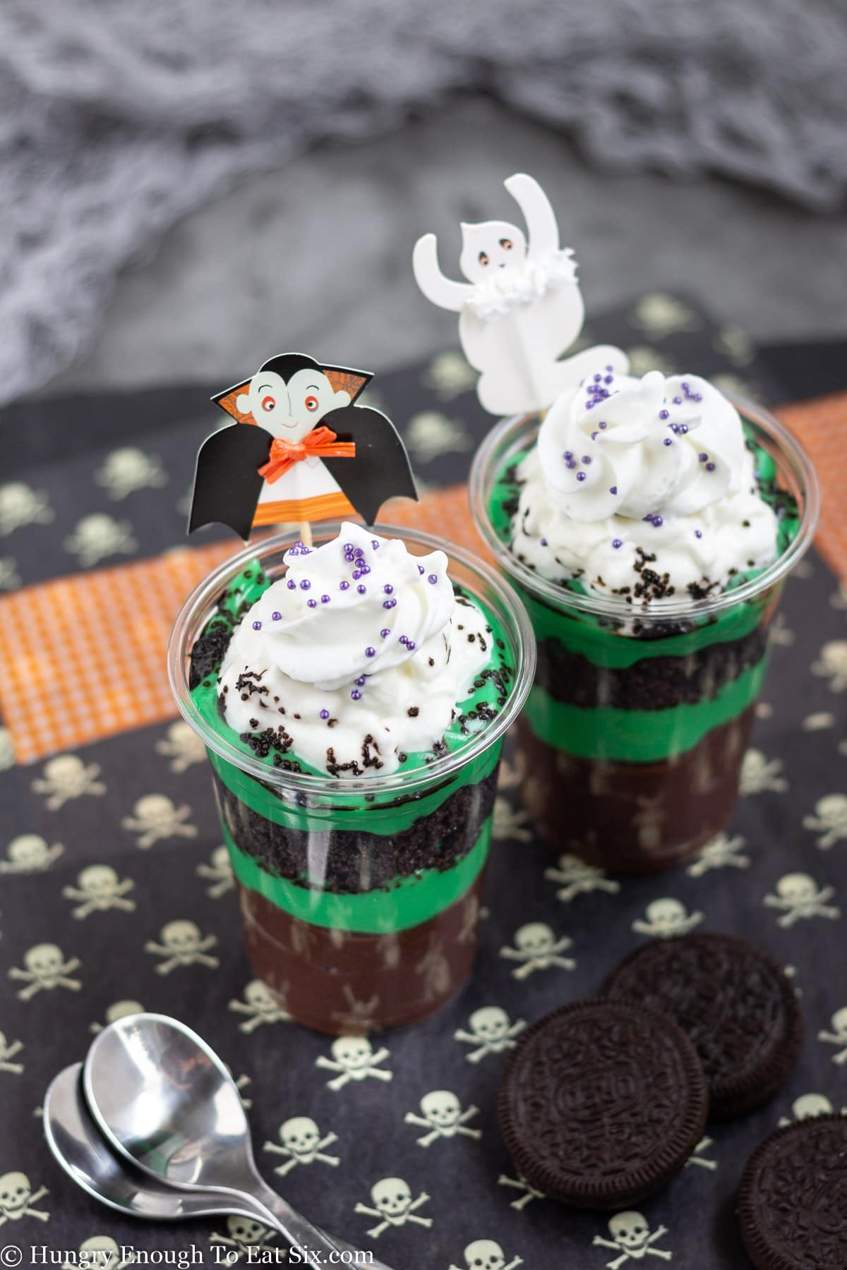 Layers of brown and green pudding in clear cups