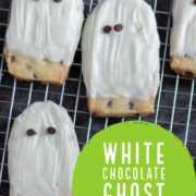 White chocolate coated ghost cookies on a metal cooling rack