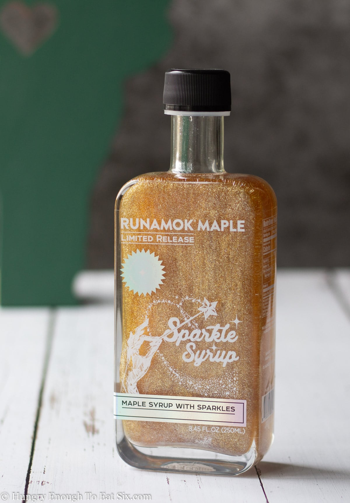 Glass bottle of sparkling maple syrup