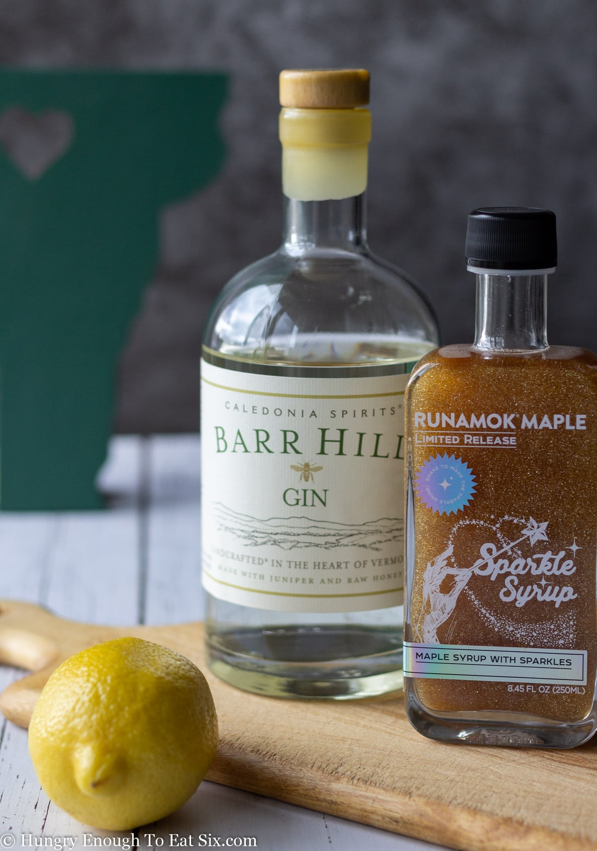 Bottles of gin and vermont maple syrup