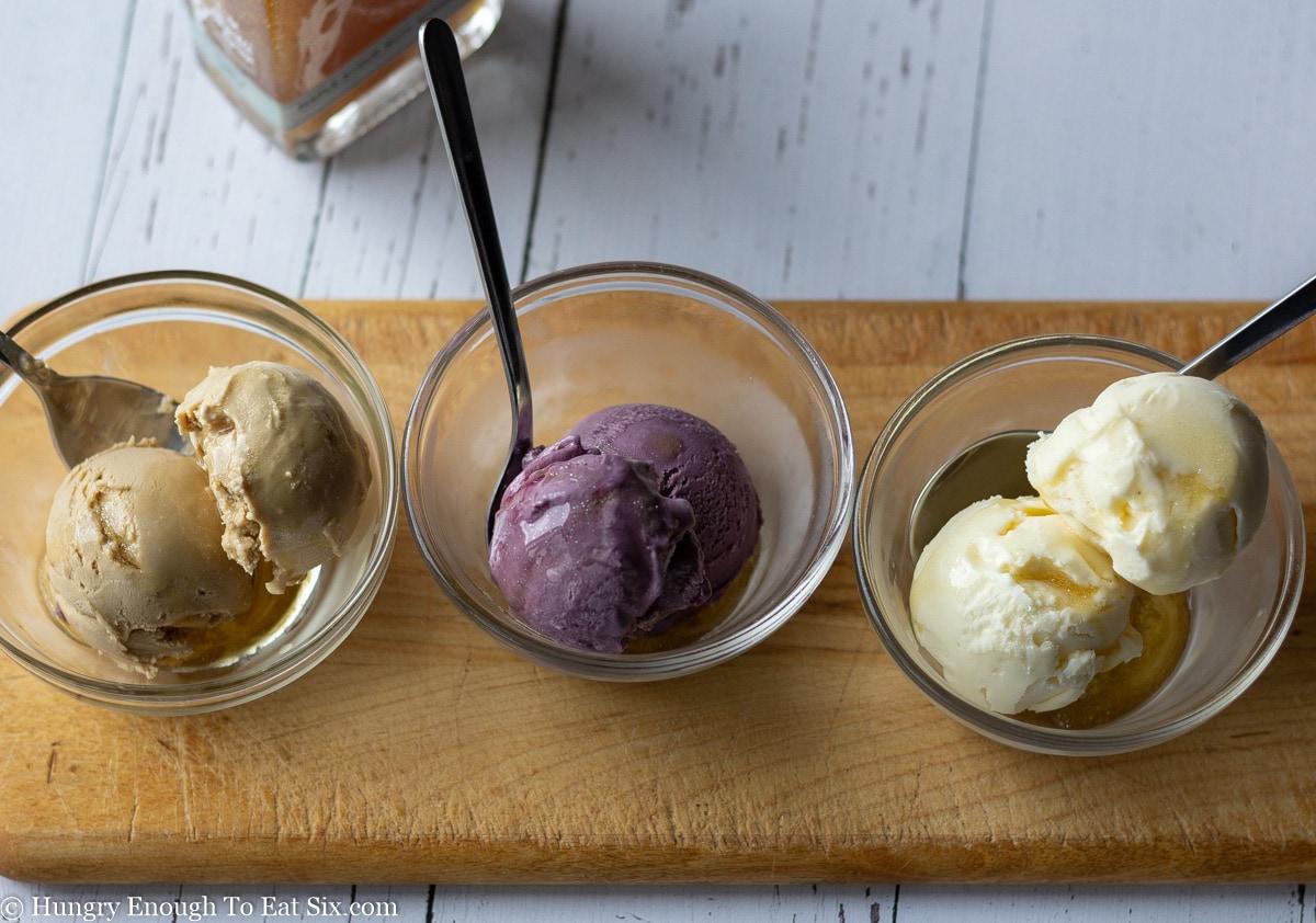 Three glass dishes of ice cream