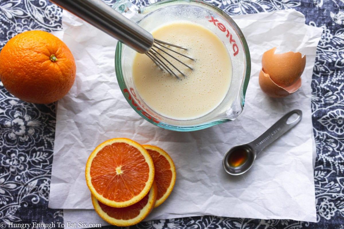Whisk in a buttermilk mixture next to orange slices