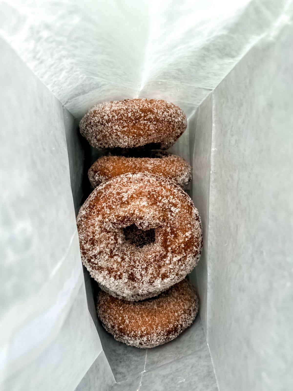 Dark brown doughnuts with sugar
