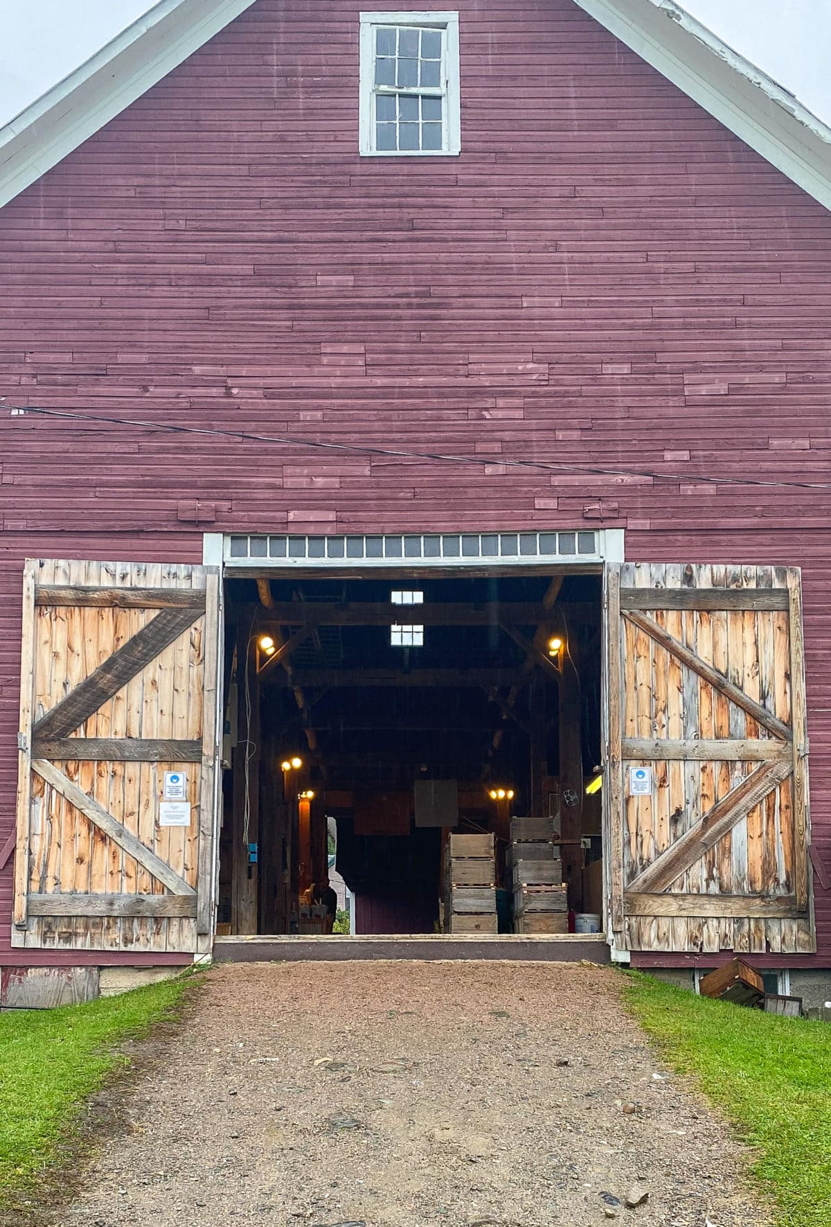 Open barn doors and red barn